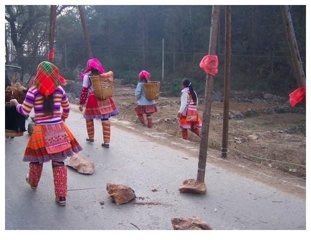 Women with baskets, Yunnan, China