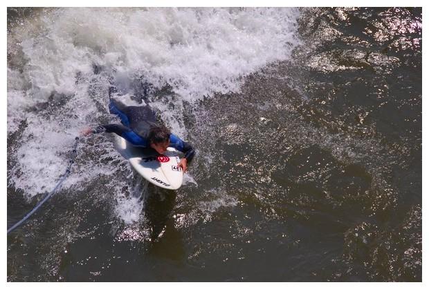Austria, Graz, practicing windsurf in river