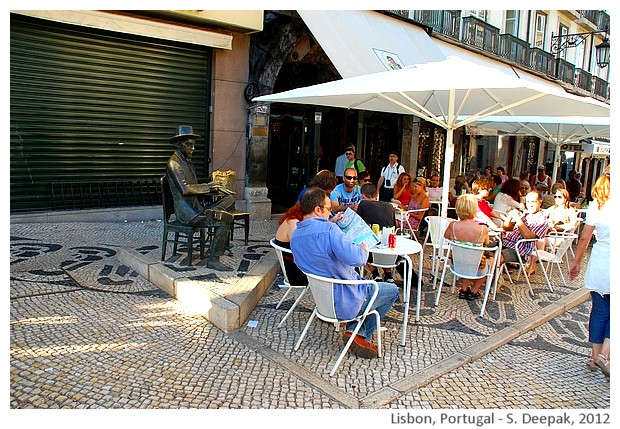 Man at restaurant statue, Lisbon, Portugal - S. Deepak, 2012