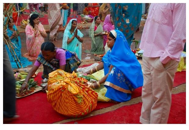 Women in blue sari, Chchath puja Delhi, India