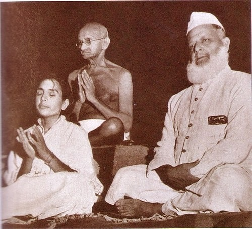 Mahatma Gandhi in a prayer meeting