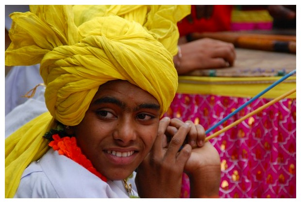 Guys wearing yellow turbans in Dilli Haat, Delhi, India