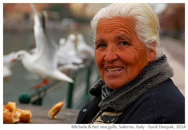 Michela giving bread to seagulls, Salerno, Italy - images by Sunil Deepak, 2014