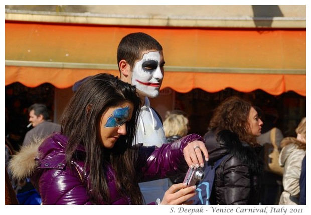 Painted faces at Venice carnival, Italy, February 2011