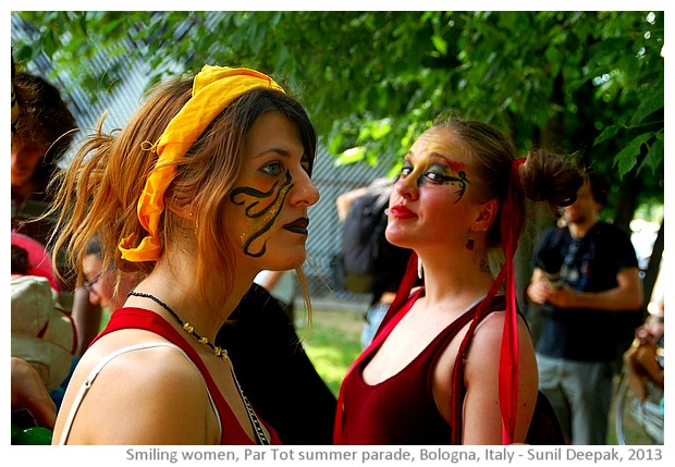 Smiling girls, Partot summer parade, Bologna, Italy - images by Sunil Deepak, 2013