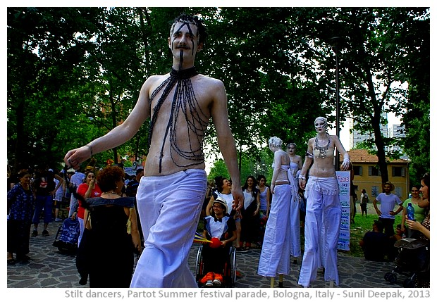 Stilt dancers, Par Tot summer parade, Bologna, Italy - images by Sunil Deepak, 2013