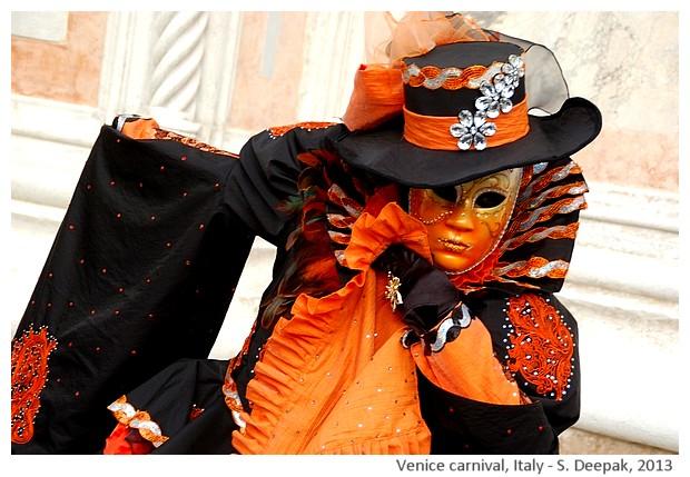 Orange and black costume at Venice carnival, Italy - S. Deepak, 2013