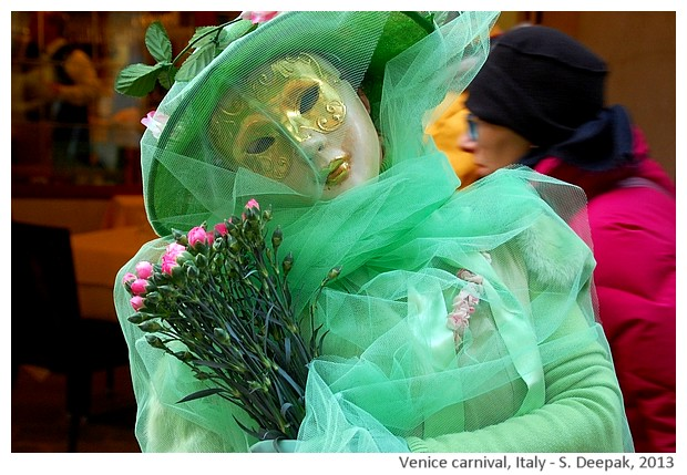Costumes in green and pink at venice carnival, Italy - S. Deepak, 2013