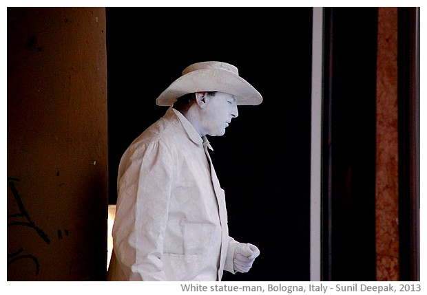 Statue man in white, Bologna, Italy - images by Sunil Deepak, 2013