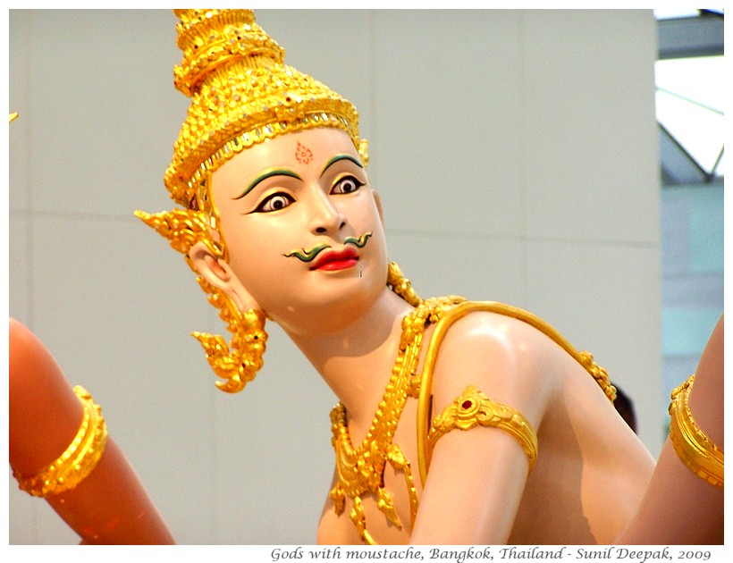 Statues of gods with moustaches, Bangkok, Thailand - Images by Sunil Deepak
