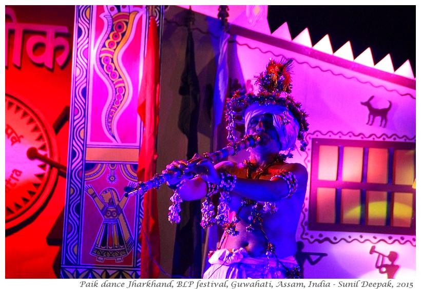 Folk dancers in blue light, Guwahati, Assam, India - Images by Sunil Deepak