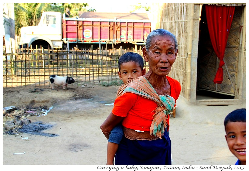 Grand-Mother carrying a baby, Assam, India - Images by Sunil Deepak