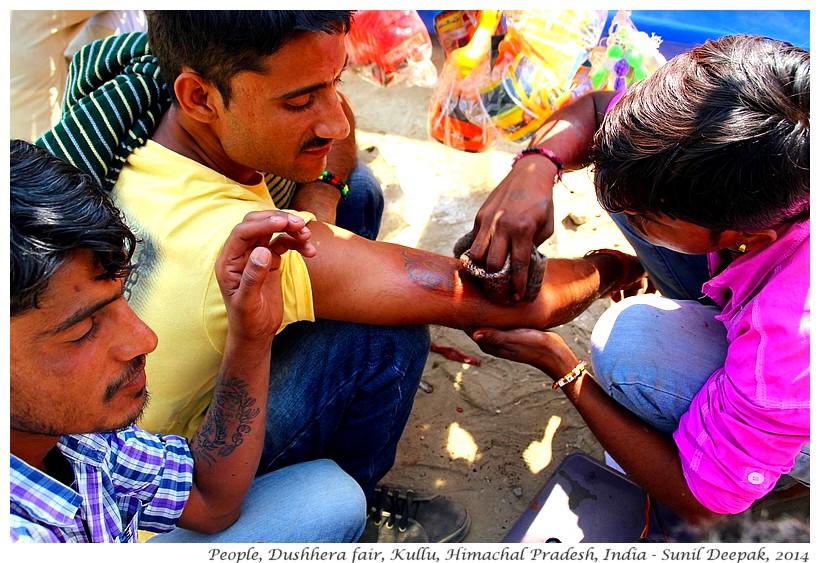 Boy getting a tatoo, Dushhera fair, Kullu, Himachal Pradesh, India - Images by Sunil Deepak
