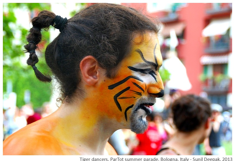 Guys in tiger makeup, Partot parade, Bologna, Italy - Images by Sunil Deepak, 2013