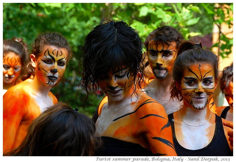 Women with tiger makeup, Par Tot parade, Bologna, Italy - Images by Sunil Deepak