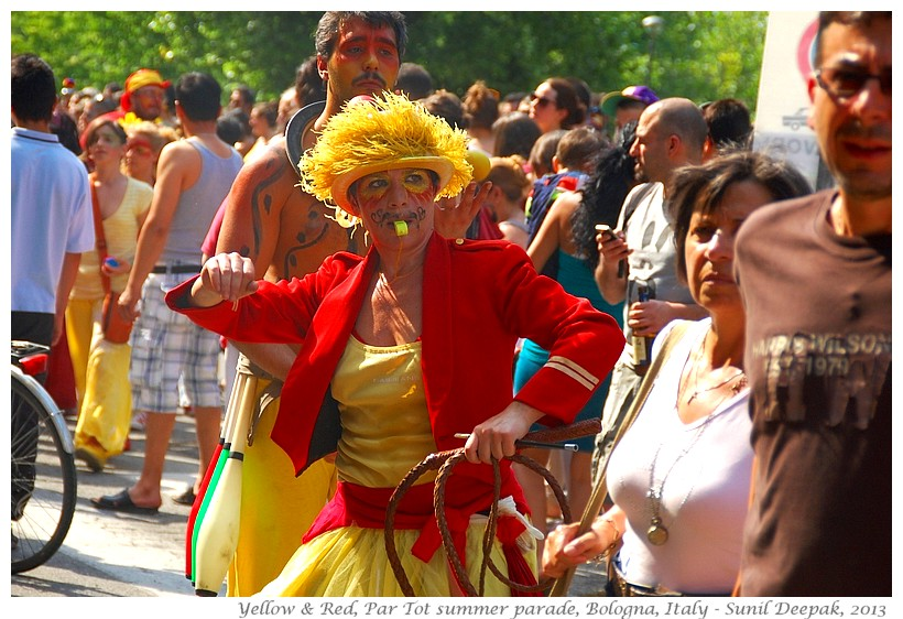 Persons in red & yellow costumes, Par tot summer parade, Bologna, Italy - Images by Sunil Deepak