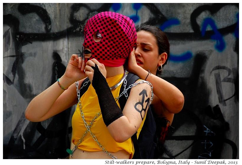 Stilt dancers prepare, Bologna, Italy - Images by Sunil Deepak